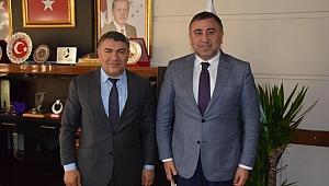 Okur'dan başkanlara ziyaret