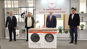 Çolakoğlu, sağlık çalışanlarına çamaşır makinesi hediye etti
